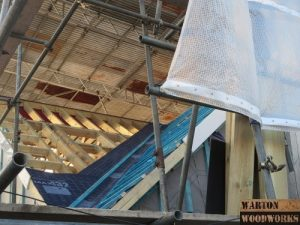 felting the roof of the hip to gable
