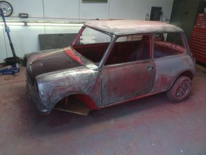 spraying a mini cooper classic 1989 red flame