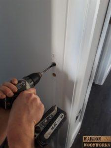 Drilling a door latch slot