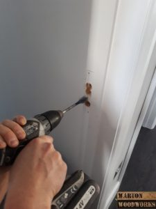 Drill out door latch slot