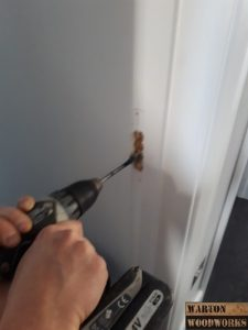 Drilling out door latch slot
